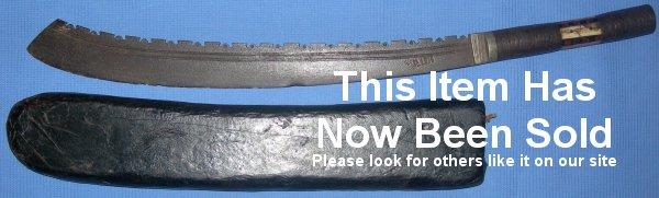 An early 20th Century Burmese Sawback Jungle Sword Machete, Sold